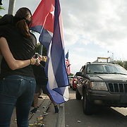 MIAMI, FL - NOVEMBER 26: Miami residents react to the news of the death of former Cuban President Fidel Castro Ruz. Many, mostly Cubans, gathered outside popular Miami restaurant Versailles to wave flags and celebrate the news, on NOVEMBER 26, 2016 in Miami, Florida. (Photo by Angel Valentin/Getty Images)