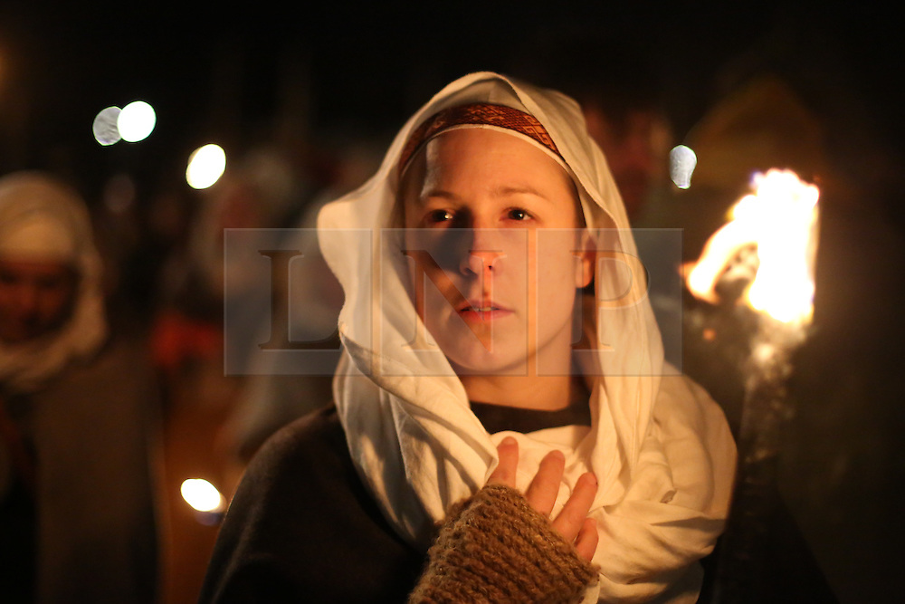 © Licensed to London News Pictures. 20/02/2016. York, UK. A woman's face is lit by a flaming torch during the finale of the annual Jorvik Viking Festival in York, North Yorkshire. The historic city was transformed into a fiery battleground as this year's end to the week long festival told the story of the infamous Battle of Assundun. The festival, which is run by the Jorvik Viking Centre, takes place every February in tradition of an ancient Viking festival known as Jolablot.  Photo credit : Ian Hinchliffe/LNP