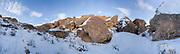 Snow blankets the floor and the tops of the volcanic rocks in the Happy Boulders, near Bishop, California.