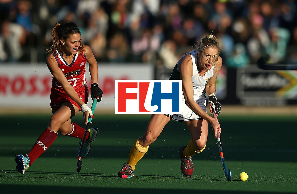 JOHANNESBURG, SOUTH AFRICA - JULY 16:  Shelley Jones of South Africa battles with Amanda Magadan of United States of America during day 5 of the FIH Hockey World League Women's Semi Finals Pool B match between South Africa and United States of America at Wits University on July 16, 2017 in Johannesburg, South Africa.  (Photo by Jan Kruger/Getty Images for FIH)