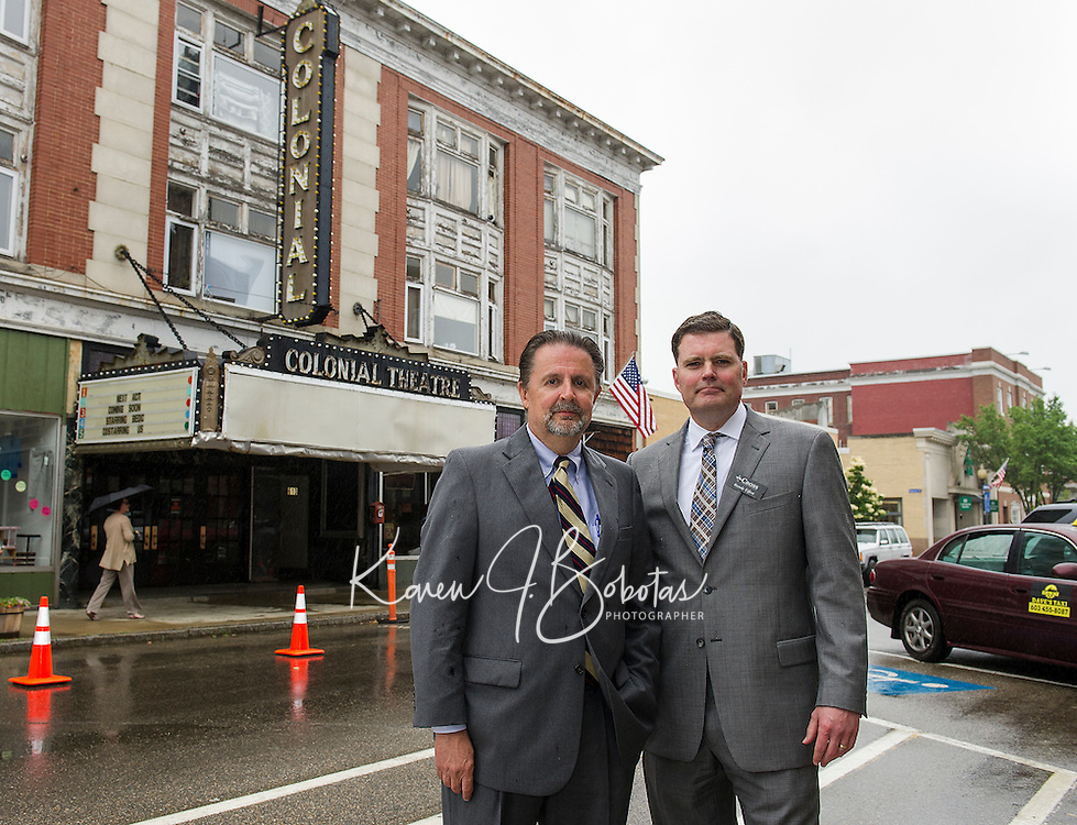 Mayor Ed Engler and Randy Eifert Vice Chair of the Belknap Economic Development Council BEDC on Main Street following the press conference announcing the purchase of the Colonial Theater in downtown Laconia.  (Karen Bobotas/for the Laconia Daily Sun)