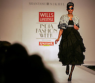 A model presents a creation by Indian desingers Shantanu and Nikhil during the India Fashion Week in New Delhi, India, Saturday, India, April 8, 2006. (AP Photo/Sebastian John)