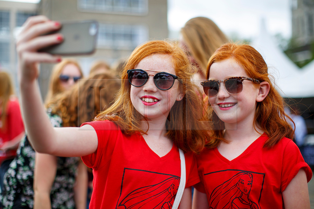 © Licensed to London News Pictures. 04/09/2016. Breda, The Netherlands. Ginger twins pose for a selfie as thousands of redheads fill a Dutch city Breda to celebrate International Redhead Day event in The Netherlands on Sunday, 4 September 2016. Every year natural redheads from more than 80 countries come together at 'Roodharigendag' annual weekend long festival to celebrate their ginger genes. The event also holds the world record for the largest number of natural redheads being in one place. Photo credit: Tolga Akmen/LNP