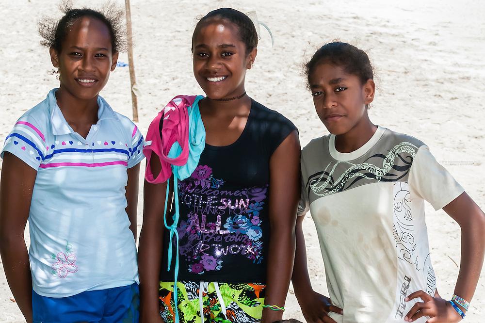 Kanak (Melanesian) girls on beach at Mebuet, island of Mare, Loyalty Islands, New Caledonia