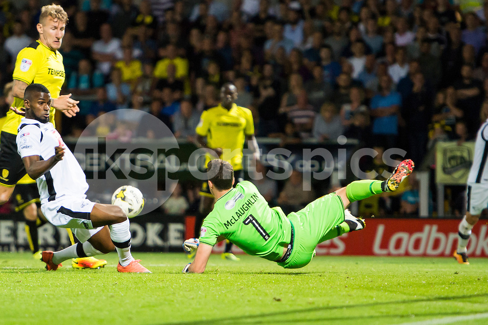 Jon McLaughlin of Burton Albion punches the ball away just before Abdoul Camara of Derby County gets to it to prevent a possible goal during the EFL Sky Bet Championship match between Burton Albion and Derby County at the Pirelli Stadium, Burton upon Trent, England on 26 August 2016. Photo by Brandon Griffiths.
