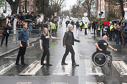 © Licensed to London News Pictures. 28/02/2020. London, UK. The Duke of Sussex and Jon Bon Jovi on the famous crossing outside Abbey Road Studios after recording a special single in aid of the Invictus Games Foundation. The song will be recorded in Studio 2 at Abbey Road Studios, which was made famous by The Beatles who recorded 11 out of their 13 albums there. Photo credit: Ray Tang/LNP