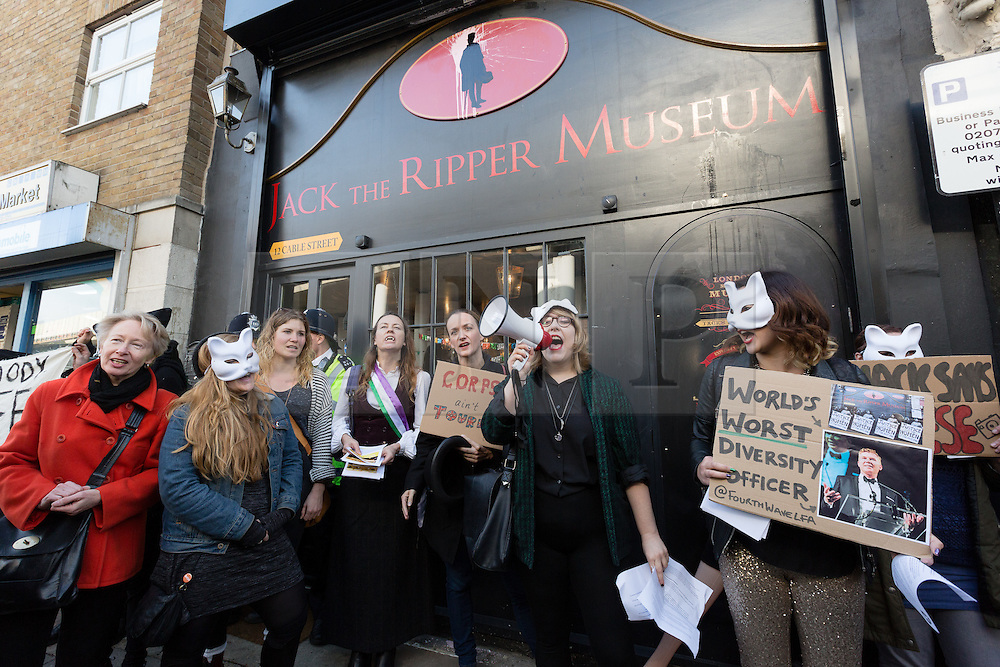 """© Licensed to London News Pictures. 31/10/2015. London, UK. Demonstrators protest outside the Jack the Ripper Museum in Cable Street, Shadwell, east London. The protest is organised by feminist group, The Fourth Wave and attended by Class War and other activists, who are protesting against a Halloween event being held at the museum this weekend, where visitors can take selfie photographs inside the museum with """"Jack the Ripper"""" and some of his female victims played by actors. Photo credit : Vickie Flores/LNP"""