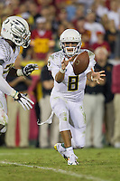 03 November 2012: Quarterback (8) Marcus Mariota of the Oregon Ducks pitches the ball against the USC Trojans during the second half of Oregon's  62-51victory over USC at the Los Angeles Memorial Coliseum in Los Angeles, CA.