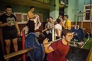 Emin Kiliç, in red, during a training session for wrestlers in one of Istanbul's oldest and most well renowned clubs. Haydarpaşa Demirspor Kulbübü, Istanbul, Turkey.