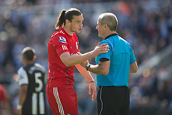 NEWCASTLE-UPON-TYNE, ENGLAND - Sunday, April 1, 2012: Liverpool's Andy Carroll is shown a yellow card by referee Martin Atkinson for diving during the Premiership match against Newcastle United at St James' Park. (Pic by David Rawcliffe/Propaganda)