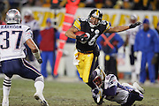 PITTSBURGH - JANUARY 23:  Wide receiver Hines Ward #86 of the Pittsburgh Steelers catches one of 5 passes for 109 yards and 1 touchdown while avoiding a tackle by cornerback Randall Gay #21 of the New England Patriots during the AFC Championship game at Heinz Field on January 23, 2005 in Pittsburgh, Pennsylvania. The Pats defeated the Steelers 41-27. ©Paul Anthony Spinelli  *** Local Caption *** Hines Ward; Randall Gay