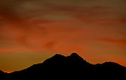 20141003_WEATHER_8288.jpg The sunset is seen over Mount Meeker and Longs Peak, Friday, Oct. 3, 2014, from Longmont.<br /> (Matthew Jonas/Longmont Times-Call)
