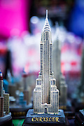 A statuette of the Chrysler Building in a souvenir shop near 42nd Street