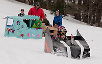 "Ty and Caleb Bartlett blast out of the start with their ""boys will be boys"" Speed Racer during Gilford Parks and Recreation cardboard sled derby at the Gilford Outing Club Wednesday morning.   (Karen Bobotas/for the Laconia Daily Sun)"