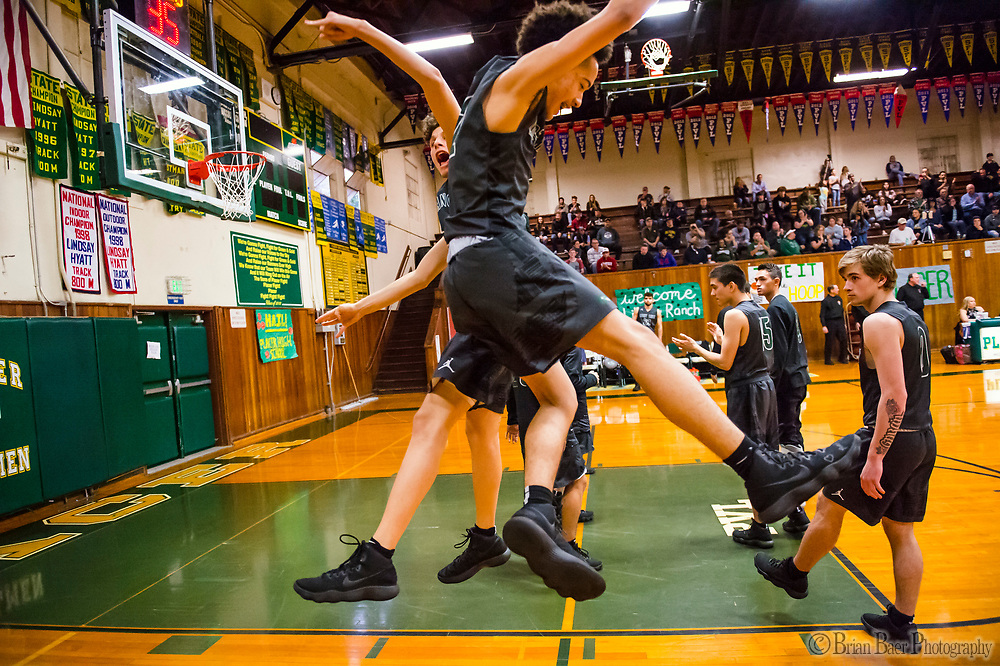 Liberty Ranch Hawks Jayden Baroni (5), and Liberty Ranch Hawks Jalen Patterson (2), jump up as they are introduced before the game as the Placer Hillman host the Liberty Ranch Hawks Varsity basketball team in the DIV NorCal boys quarterfinal, Saturday Mar 10, 2018.  <br /> photo by Brian Baer