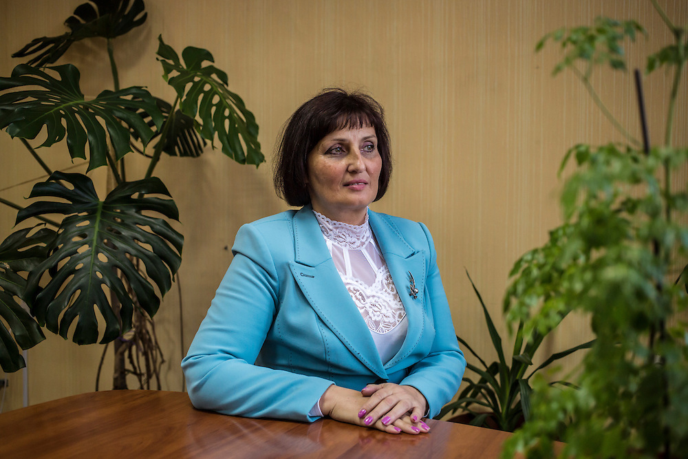 Lydmila Shapoval, a local deputy administrator responsible in part for assisting people displaced by fighting in Eastern Ukraine, poses for a portrait in her office on Tuesday, October 14, 2014 in Berdyansk, Ukraine. Photo by Brendan Hoffman, Freelance