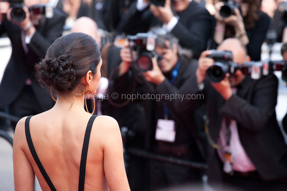 Actress Golshifteh Farahani with photographers at the gala screening for the film Paterson at the 69th Cannes Film Festival, Monday 16th May 2016, Cannes, France. Photography: Doreen Kennedy