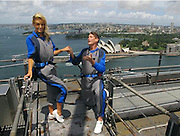 31.JAN.2011<br /> Did she say yes? David Hasselhoff proposes to girlfriend Hayley Roberts on top of the Sydney Harbour Bridge<br /> <br /> He may have already popped the question twice to girlfriend Hayley Roberts, but her snubs didn't put David Hasselhoff off asking the pretty blonde again - this time on top of the Sydney Harbour Bridge.<br /> And it seems the Baywatch actor's toygirl may have said yes, judging by the picture the Baywatch actor posted on his Twitter page.<br /> Hasselhoff was seen on bended knee as he asked Hayley, 32, to marry him, before kissing the Welsh beauty in a passionate embrace.<br /> The 59-year-old actor captioned his second picture with the words: 'What do you think she said?!'<br /> And while Hayley didn't confirm the news on her Twitter page, she did post a crypitc: ':-)))))) xxxxxxxxxxxx'<br /> A representative for Hasselhoff has yet to confirm the news.<br /> <br /> Hasselhoff previously proposed to his girlfriend twice last year, as the pair holidayed in Cape Town, South Africa, but Hayley said no.<br /> <br /> The proposals came after Hasselhoff, who has two daughters from a previous marriage, hinted that he is ready to get married for a third time.<br /> He admitted: 'I believe you should only marry people if you can't live without them.<br /> 'If you can live with them, live with them. Right now with Hayley things are getting better in every way.<br /> 'I've thought about the age gap and it doesn't bother me or Hayley I hope.'<br /> The couple have been together for nearly a year after meeting when Hayley asked for his autograph at the Britain's Got Talent auditions in Cardiff, Wales.<br /> If Hasselhoff is engaged it will be the third marriage for the actor. <br /> He was married to Catherine Hickland from 1984 to 1989. <br /> He then married Pamela Bach on December 9, 1989, and the couple had two daughters - Taylor and Hayley. <br /> Hasselhoff filed for divorce from Bach in January 2006 citing irreconcilable differences.<br /> ©Exclusivepix