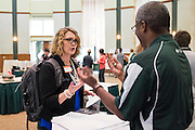 Claire Berlin chats with UCM's George Mauzy during the CCN Expo in Walter Hall Rotunda on Wednesday, May 13, 2015.  Photo by Ohio University  /  Rob Hardin