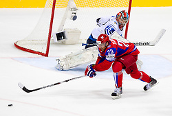 Teemu Lassila of Finland vs Danis Zaripov of Russia during ice-hockey match between Russia and Finland of Group E in Qualifying Round of IIHF 2011 World Championship Slovakia, on May 9, 2011 in Orange Arena, Bratislava, Slovakia. (Photo By Vid Ponikvar / Sportida.com)