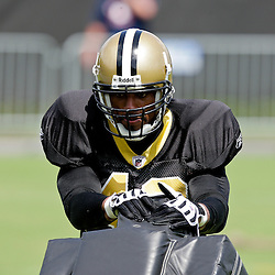 01 August 2009: New Orleans Saints safety Darren Sharper (42) works with a tackling dummy on the field during New Orleans Saints training camp at the team's practice facility in Metairie, Louisiana.