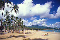 Luquillo beach scene with El Yunque rainforest in the background.