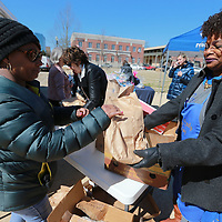 Regina Coggins, left, and Shirley Hendrix help get unpack bowls at Fairpark in Tupelo as the Salvation Army set up it's canteen as a second location rfor their annual Empty Bowl Luncheon findraiser Wednesday.