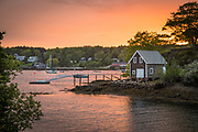 A summer sunset over the picturesque village of Christmas Cove, South Bristol, Maine