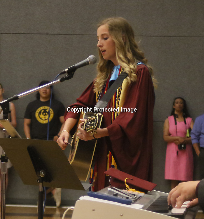 "Smithville graduate Whitney Moody sings Carrie Underwood's ""Whenever You Remember"" during the school's graduation ceremony May 18."