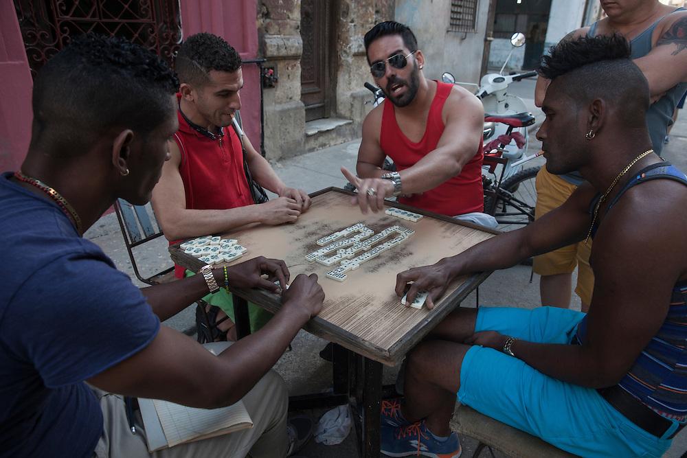 A group of men play domino on the streets of Habana Centro, in Havana, Cuba.<br /> <br /> Grupo de hombres jugando al domin&oacute; en una calle de Centro Hana.