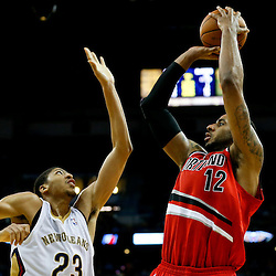 Dec 30, 2013; New Orleans, LA, USA; Portland Trail Blazers power forward LaMarcus Aldridge (12) shoots over New Orleans Pelicans power forward Anthony Davis (23) during the second half of a game at the New Orleans Arena. The Pelicans defeated the Trail Blazers 110-108. Mandatory Credit: Derick E. Hingle-USA TODAY Sports