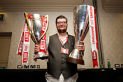 A VIP poses with the trophies after the Bristol City open top bus parade to celebrate winning both the League 1 and Johnstone's Paint Trophy titles this season and promotion to the Championship - Photo mandatory by-line: Rogan Thomson/JMP - 07966 386802 - 04/05/2015 - SPORT - FOOTBALL - Bristol, England - Bristol City Bus Parade.