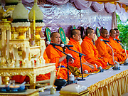 01 JANUARY 2019 - BANGKOK, THAILAND:   Buddhist monks chant during the New Year's merit making ceremony on the plaza in front of City Hall in Bangkok. City Hall traditionally hosts one of the largest New Year merit making ceremonies in Thailand. This year about 160 monks participated in the event.     PHOTO BY JACK KURTZ