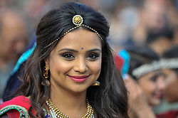 © Licensed to London News Pictures. 15/10/2017. London, UK. A traditional garba dancer performs at Diwali, the 'Festival of Lights', in Trafalgar Square.  Hosted by Sadiq Khan, Mayor of London, organisers present a variety of cultural activities and entertainment for visitors to enjoy.  Diwali is observed annually by Hindus, Sikhs and Jains in India and many other countries around the world.   Photo credit : Stephen Chung/LNP