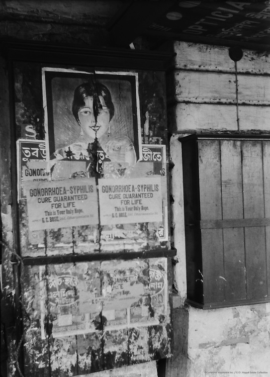 Advertising a Remedy for Venereal Disease in Main Street, Calcutta, India, 1929