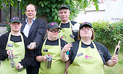 Stephen Hammond, Conservative parliamentary candidate for Wimbledon and the former parliamentary under-secretary of State for Transport is on the general election campaign trail in Wimbledon today (Monday 15th May 2017). <br /> <br /> Visiting the Merton Mencap Caf&eacute;, open every Monday at Holy Trinity Church in The Broadway it offers a range of healthy home-made dishes &amp; is run by adults with a learning disability, supported by Merton Mencap staff and volunteers. <br /> <br /> Hammond who has an 11,408 majority (24.1%) met some of the workers who have learning disabilities including <br /> <br /> L to R: <br /> <br /> back row:<br />  Stephen Hammond ; Richard Dorris <br /> <br /> front row:<br /> <br /> George Cary ; Neil Weddell ; Anna Caldicott<br /> <br /> <br /> <br /> Photograph by Elliott Franks <br /> Image licensed to Elliott Franks Photography Services