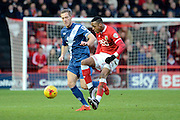 Bristol City striker Jonathan Kodjia plays the ball away from Birmingham City defender Michael Morrison during the Sky Bet Championship match between Bristol City and Birmingham City at Ashton Gate, Bristol, England on 30 January 2016. Photo by Alan Franklin.
