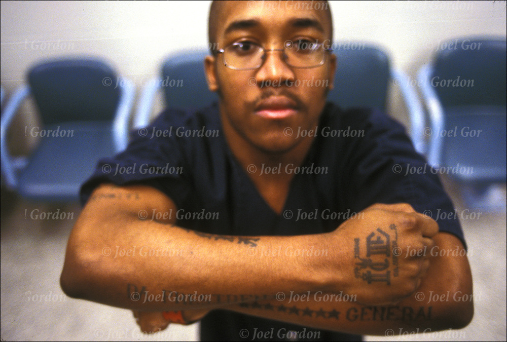 African American inmate in jail, close-up, gang-identifying tatoo, Insane Ganster Disciple,Tag ICE membber of Folk Nation, Orange County Jail, FL