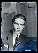 intense looking at camera young adult man portrait France ca 1920s