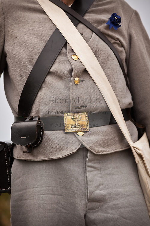 Details on the uniform of a Confederate re-enactor Charleston, SC. The re-enactors are part of the 150th commemoration of the US Civil War.
