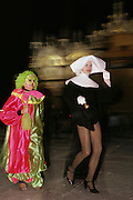 Costumed revelers, a nun in drag and a clown, at Winter Carnival in Venice, Italy.