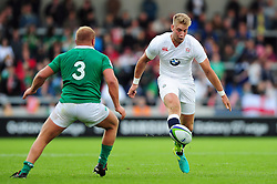 Harry Mallinder of England U20 puts in a grubber kick - Mandatory byline: Patrick Khachfe/JMP - 07966 386802 - 25/06/2016 - RUGBY UNION - AJ Bell Stadium - Manchester, England - England U20 v Ireland U20 - World Rugby U20 Championship Final 2016.