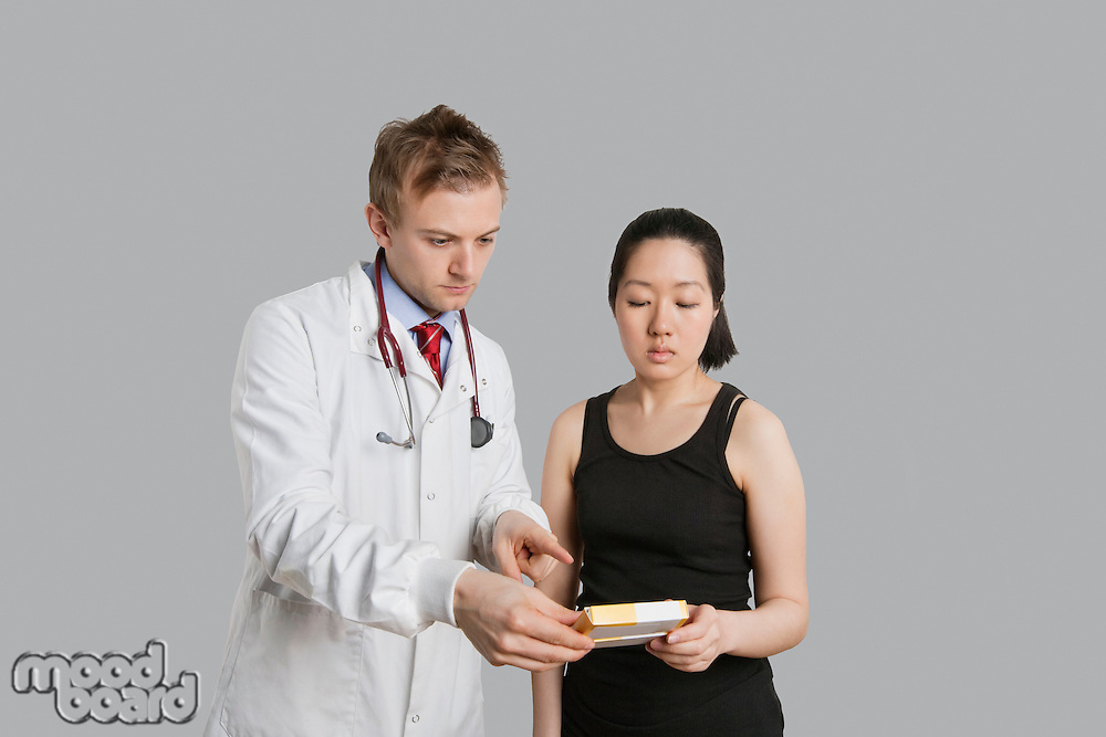 Male doctor suggesting medication to female patient.