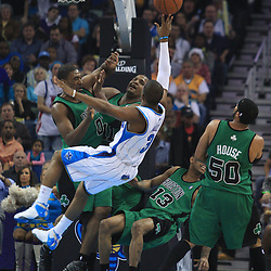 11 February 2009:  New Orleans Hornets guard Chris Paul (3) shoots and draws the foul over the Boston Celtics defense during a NBA game between the Boston Celtics and the New Orleans Hornets at the New Orleans Arena in New Orleans, LA.