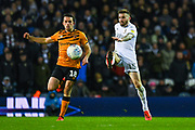 Leeds United defender Stuart Dallas (15) passes the ball during the EFL Sky Bet Championship match between Leeds United and Hull City at Elland Road, Leeds, England on 10 December 2019.