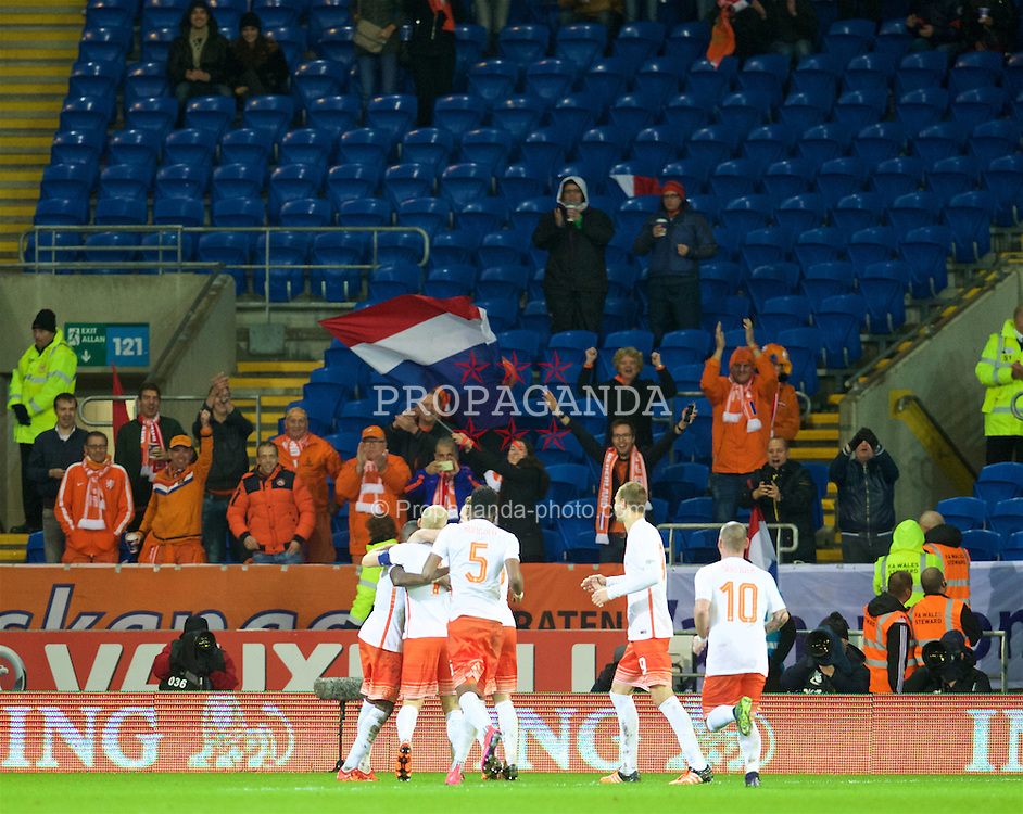 CARDIFF, WALES - Friday, November 13, 2015: The Netherlands' captain Arjen Robben celebrates scoring the second goal against Wales during the International Friendly match at the Cardiff City Stadium. (Pic by David Rawcliffe/Propaganda)