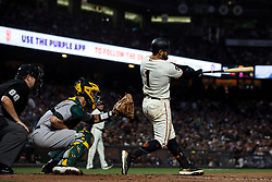 SAN FRANCISCO, CA - AUGUST 13: Kevin Pillar #1 of the San Francisco Giants hits an RBI double against the Oakland Athletics during the sixth inning at Oracle Park on August 13, 2019 in San Francisco, California. The San Francisco Giants defeated the Oakland Athletics 3-2. (Photo by Jason O. Watson/Getty Images) *** Local Caption *** Kevin Pillar