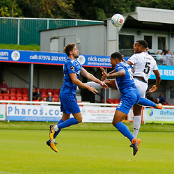 Dovers defender Kevin Lokko wins the ball in the air during the National League match between Dover Athletic FC and Eastleigh FC at Crabble Stadium, Kent on 25 August 2018. Photo by Matt Bristow.