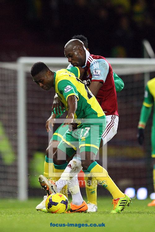 Picture by Paul Chesterton/Focus Images Ltd +44 7904 640267<br /> 11/02/2014<br /> Alexander Tettey of Norwich and Carlton Cole of West Ham in action during the Barclays Premier League match at the Boleyn Ground, London