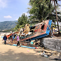 Destroyed Fishing Boat Teetering on Ledge After Tsunami on Patong Beach in Phuket, Thailand <br />